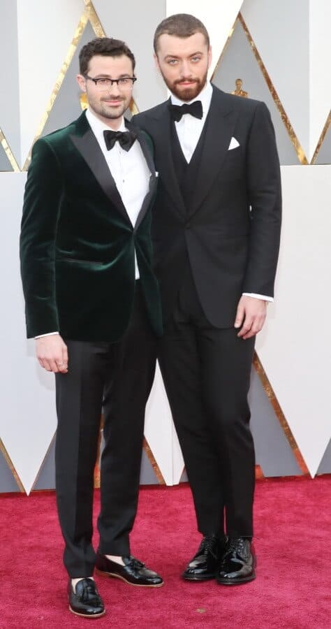 Sam Smith and unknown - velvet green dinner jackets are nice but sockless tassel loafers are not for black tie events