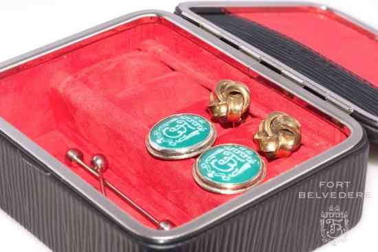 Compartment for collar pins, cuff links and other tid bits in the travel men's jewelry kit