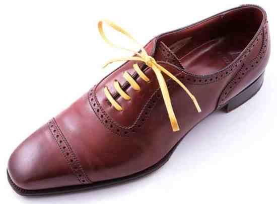 Yellow Shoelaces on Brown Oxford