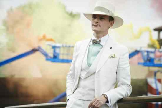 Off white 3 piece suit, pastel green winchester shirt, Panama hat and self tie bow tie