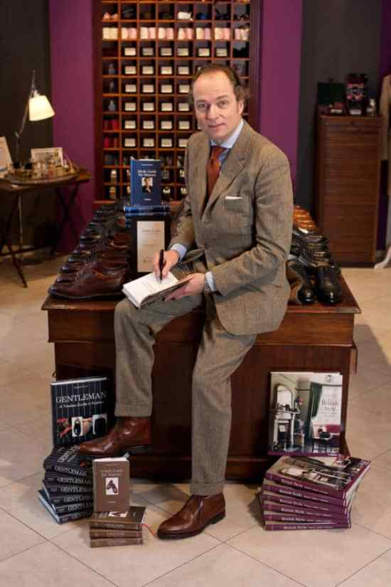 Bernhard Roetzel in a tweed suit signing his book