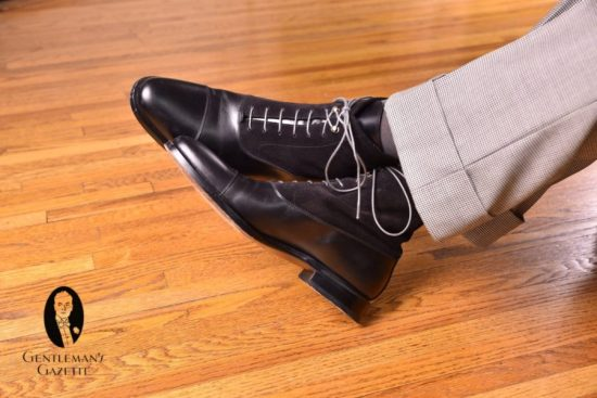 black balmoral boots with dark grey socks with houndstooth trousers