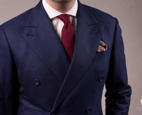 Navy suit with burgundy grenadine tie