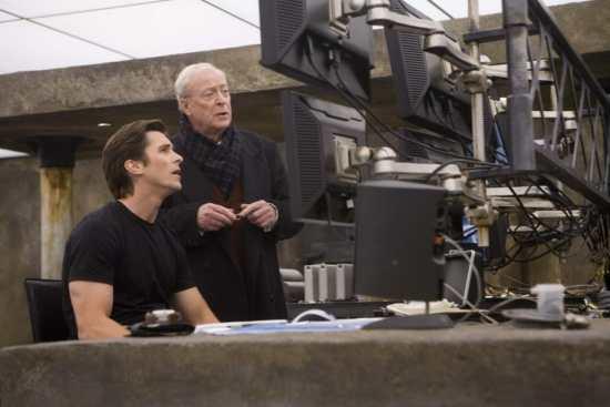 Christian Bale as Bruce Wayne wearing a Sunspel shirt.