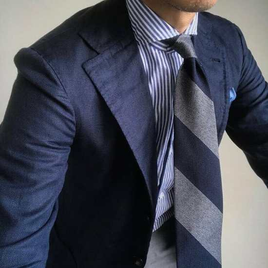 @nfld_rm55 wearing a blue and gray block stripe tie.