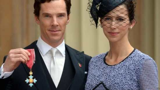 Benedict Cumberbatch (with CBE cross on hand) and wife Sophie Hunter
