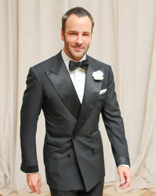 Tom Ford in a double-breasted tuxedo with peak lapels and jetted pockets.