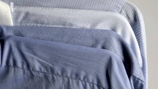 A selection of light blue dress shirts in different shades