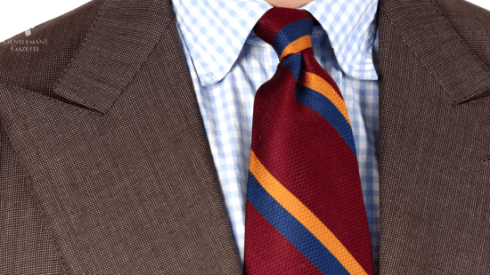 Pinpoint suit and repp tie