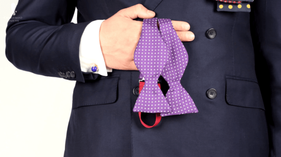 Purple bow tie with white spots