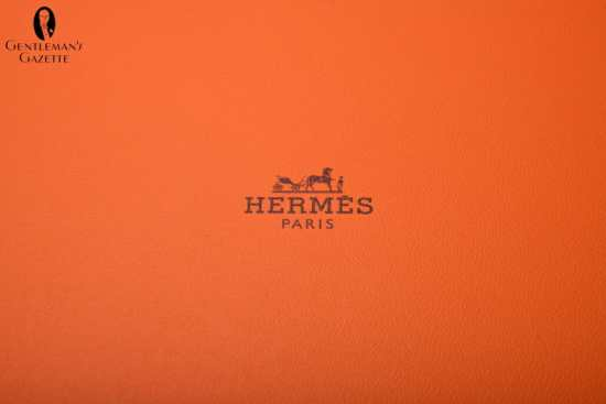 Logo of orange Hermes tie box