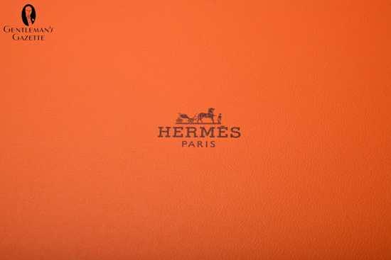 Logo of orange Hermes tie box