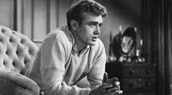 Dean wearing a buff-colored sweater with khakis and a collared shirt in East of Eden.