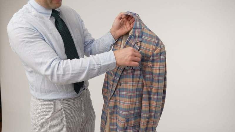 Raphael holding a madras jacket