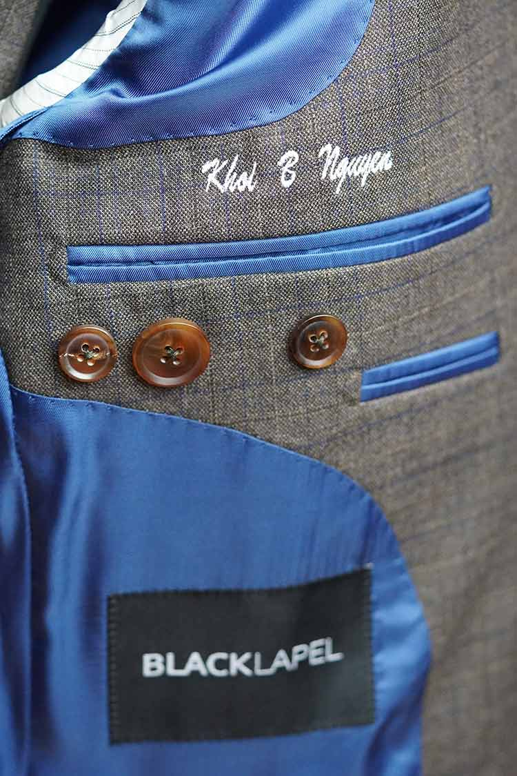 Inside Jacket Monogram Button Tag Detail