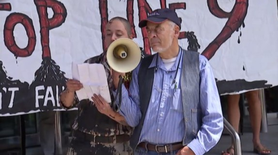 Iranian government ally Ken Stone holds the megaphone...