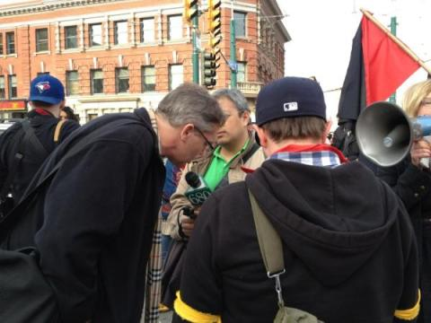Greg Renouf being interviewed by 680 News At Toronto's May Day Parade...