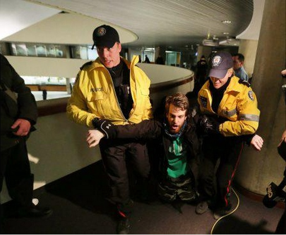 "Pretester ""Squid Newb"" being pulled-out of Toronto City Hall back in February..."