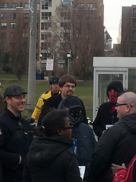 Steve Anderson of Rabble.ca (far left), Jared Anderson of York University SAIA (centre, behind masked anarchist)