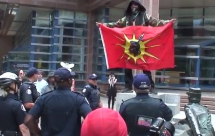 Gary Wassaykeesic (with flag) taunting the police...