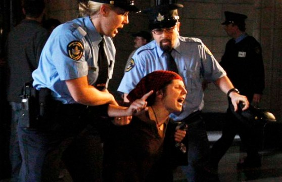 Chelsea Flook plays the role of a protester being brutally oppressed...