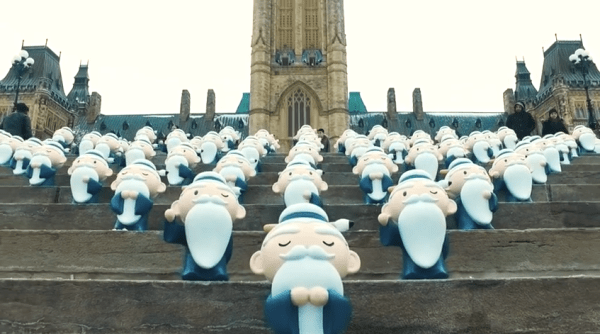 Hello Kitty Kongzi on the stairs of Canadian Parliament