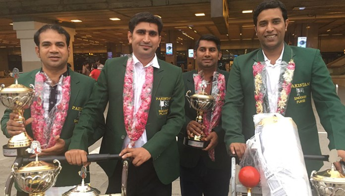"""""""Are we not country's hero,"""" questions victorious Snooker team as players return home. 