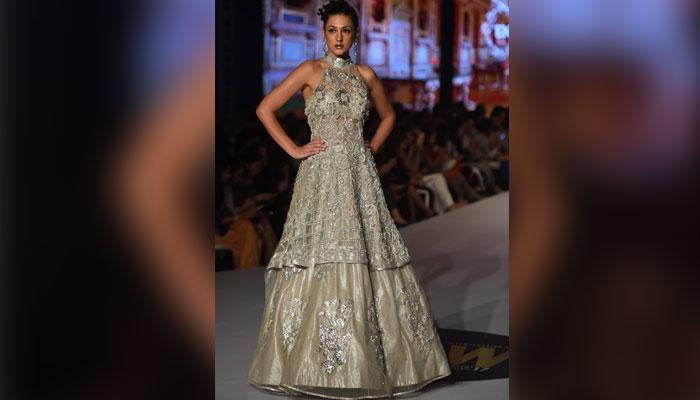 Model in a dress by designer Erum Khan. Photo: AFP