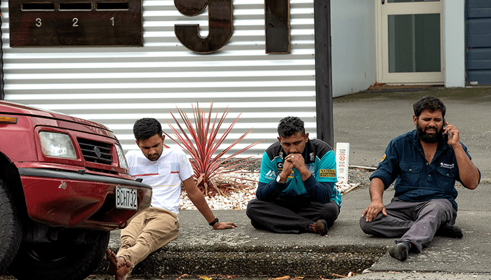 Grieving members of the public following a shooting at the Al Noor mosque in Christchurch, New Zealand. PHOTO: REUTERS
