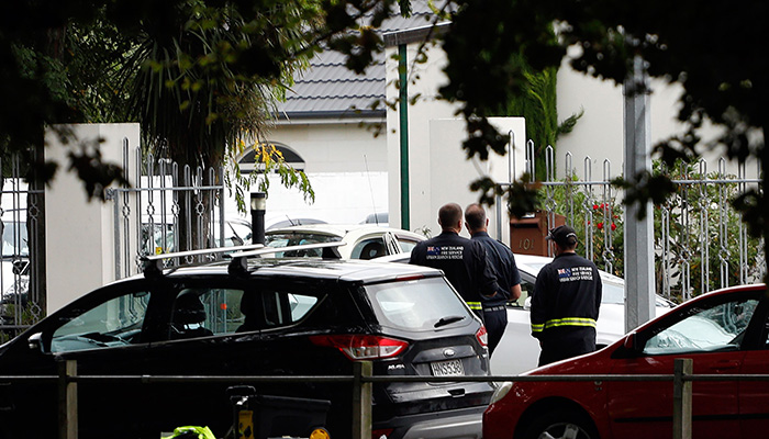 Security officials walk outside the Masjid al Noor mosque after a shooting incident in Christchurch. PHOTO: AFP
