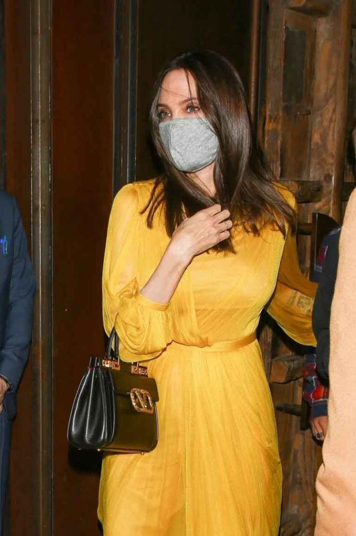 354008 2934885 updates Angelina Jolie sends pulses racing as she steps out in yellow dress with her loved ones
