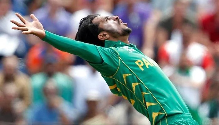 Pakistani right-arm fast bowler Hassan Ali celebrates in his signature style. Photo: Reuters