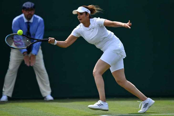Indias Sania Mirza plays a shot during her womens doubles first round match with on the fourth day of the 2021 Wimbledon Championships at The All England Tennis Club in Wimbledon, southwest London, on July 1, 2021. — AFP/Ben Stansall