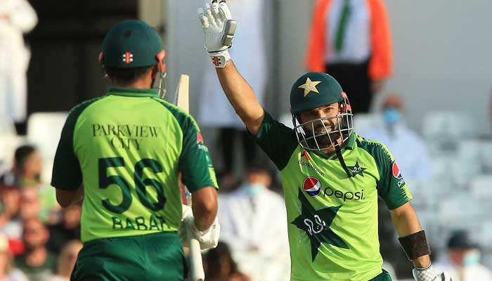 Mohammad Rizwan (R) celebrates his half century during a T20 cricket match between England and Pakistan at Trent Bridge, Nottingham, England on July 16, 2021. Photo: AFP