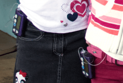 Two young girls wearing insulin pumps.