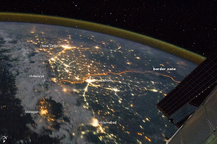 Photo of the Indo-Gangetic Plain taken from the International Space Station showing the orange lit border between India and Pakistan. Source: NASA, August 2011.