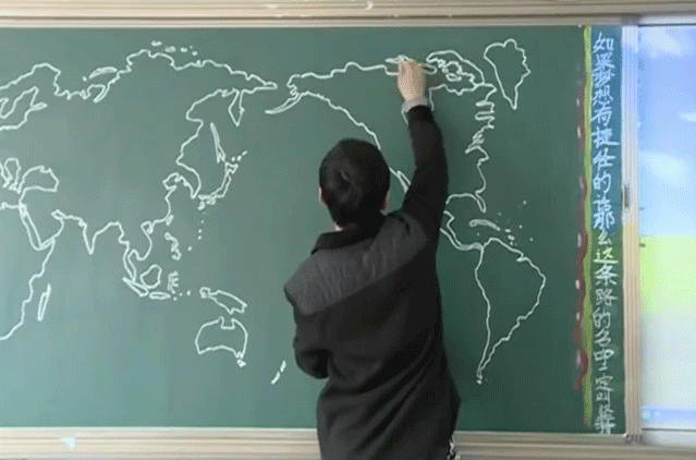Boming Wang draw his map of the world on a chalkboard.