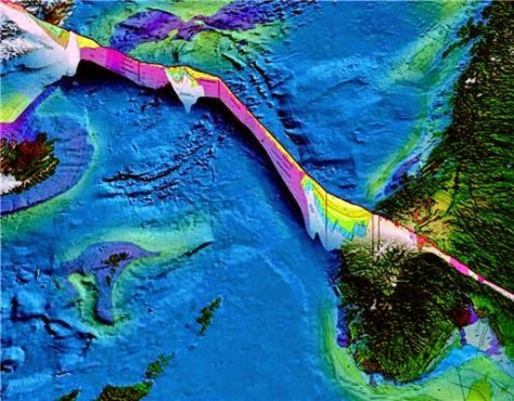 The islands along the Mid-Atlantic Ridge, such as Iceland and Jan Mayen, were created from red-hot lava escaping from the Earth's crust. The illustration shows a cross-section of the different layers of rock in the Earth's crust, both on land and the seabed. Areas along this fissure can be the source of valuable minerals.  Credit: Geological Survey of Norway