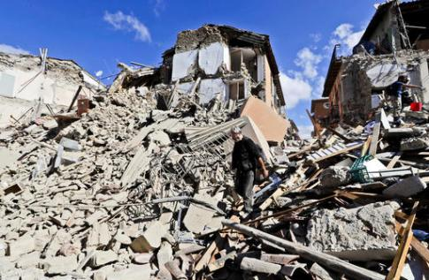 A man walks amid rubbles after an earthquake struck in Amatrice Italy, Wednesday, Aug. 24, 2016. The magnitude 6 quake struck at 3:36 a.m. (0136 GMT) and was felt across a broad swath of central Italy, including Rome where residents of the capital felt a long swaying followed by aftershocks.(AP Photo/Alessandra Tarantino)