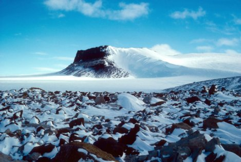 Sirius Group exposures near Mt. Fleming, Antarctica, circa 1986. The pattern of snow behind rocks shows the prevailing winds across the East Antarctic Ice Sheet. Credit: Reed Scherer, Northern Illinois University