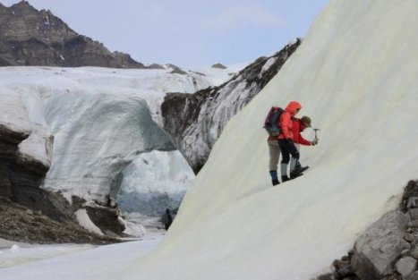 Associate Professor Alexis Templeton and Dr. Stephen Grasby prospecting for sulfur biominerals in a yellow sulfur deposit forming on a glacier surface in the High Arctic. Credit: John Spear