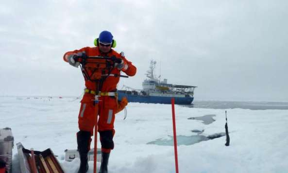 Aleksey Shestov works on the ice during the last leg of the Norwegian Polar Institute's N-ICE 2015 expedition. Credit: Marcel Nicolaus