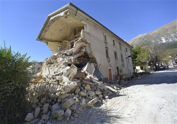 A destroyed house in the village of Pretare, near Arquata del Tronto, Italy, Tuesday, Nov. 1, 2016. Earthquake aftershocks gave central Italy no respite on Tuesday, haunting a region where thousands of people were left homeless and frightened by a massive weekend tremor that razed centuries-old towns. Credit: AP Photo/Sandro Perozzi