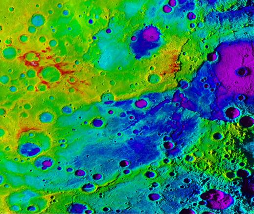 Using colorized topography, Mercury's 'great valley' (dark blue) and Rembrandt impact basin (purple, upper right) are revealed in this high-resolution digital elevation model merged with an image mosaic obtained by NASA's MESSENGER spacecraft. Credit: NASA/JHUAPL/Carnegie Institution of Washington/DLR/Smithsonian Institution