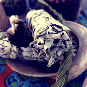 sage smudge stick and sweetgrass