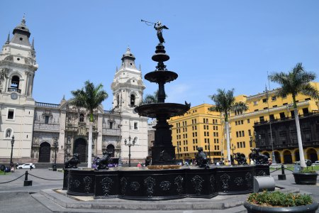 The Plaza de Armas in the Historic Centre of Lima. The bronze fountain, erected in 1650, sits in the Plaza's center. The Cathedral of Lima is seen here directly in back of the fountain.