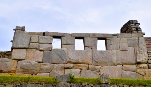 The Temple of Three Windows well illustrates the ashlar building technique used by Inca builders - precisely cut stone blocks (in this case granitoid blocks) that fit so well with adjoining blocks that no mortar is needed.