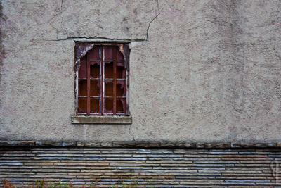 window and cracked wall