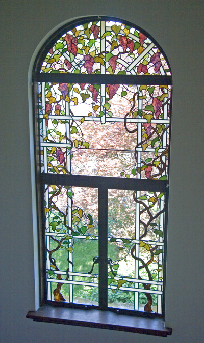 Stained glass window with grape vines