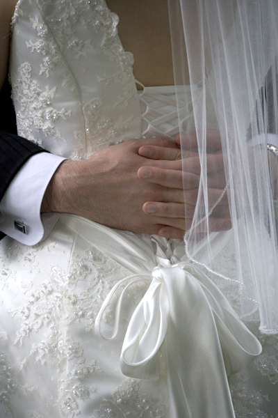 hands and gown